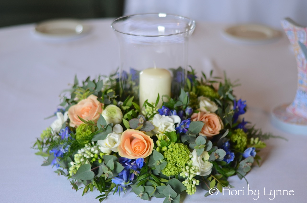 wreath,peach-roses,blue-delphinium,white,mint-spring-flowers,stormLantern,candle.jpg