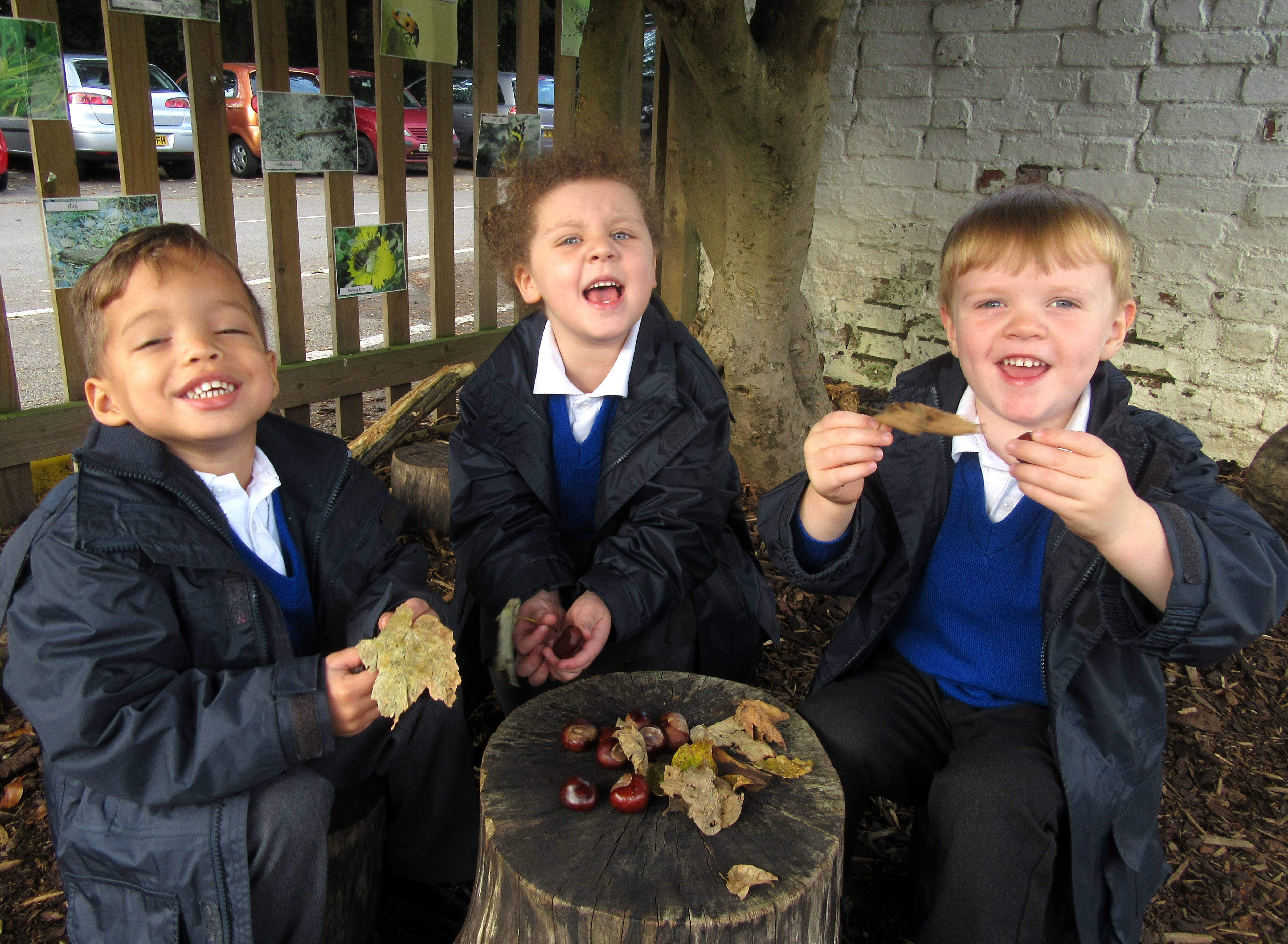 Nursery Children Delight in Autumn Colour