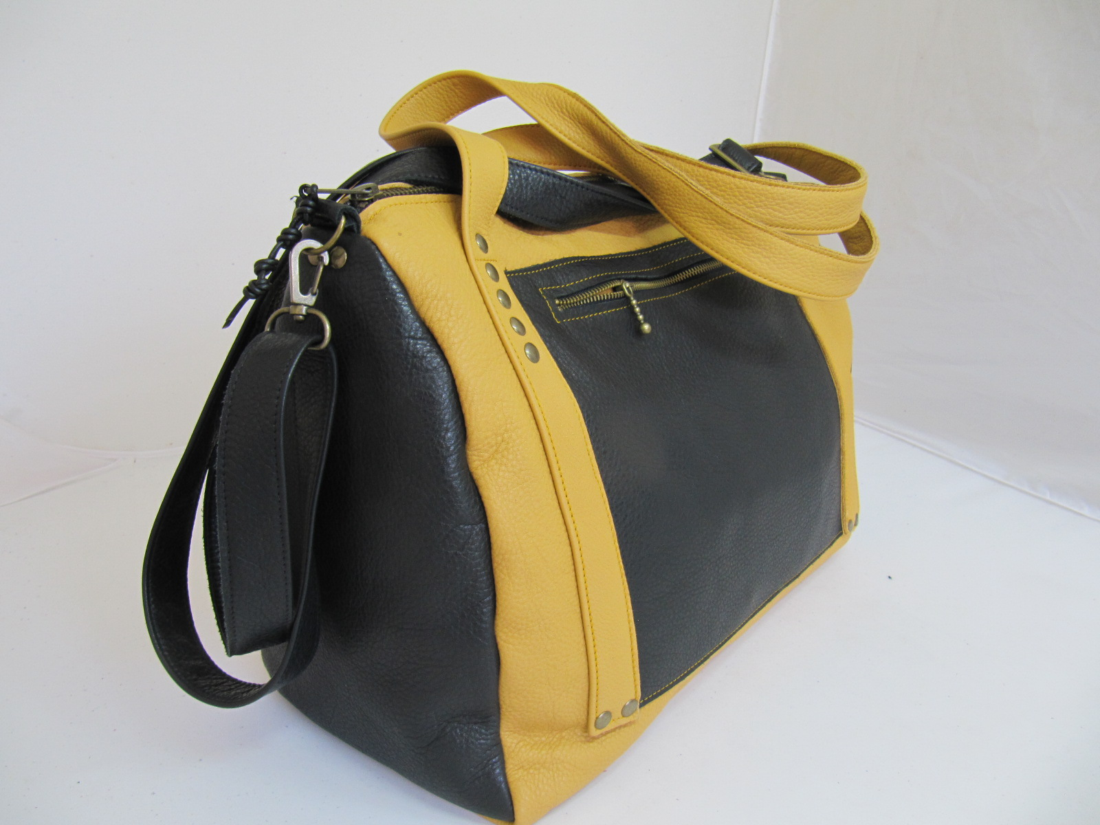 Mustard and black leather handbag