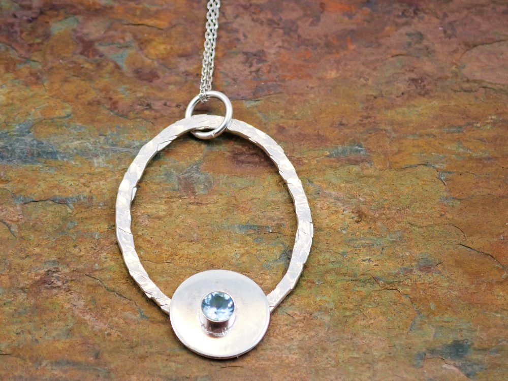 Topaz oval hammered effect pendant