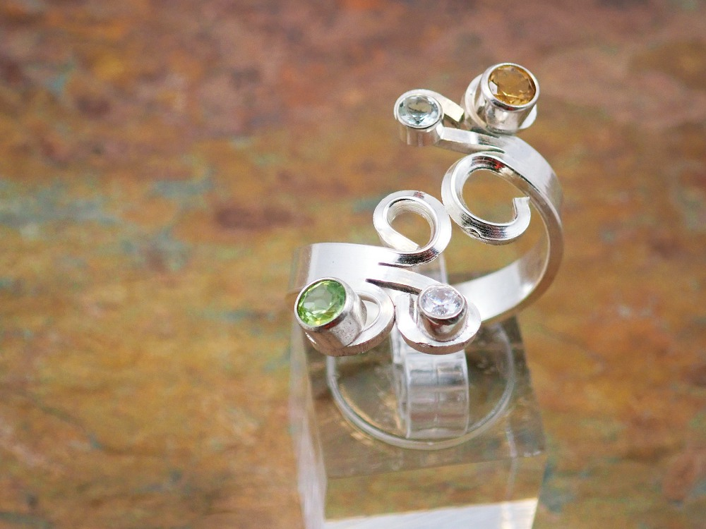 Citrine, peridot and cubic zirconia spiral ring