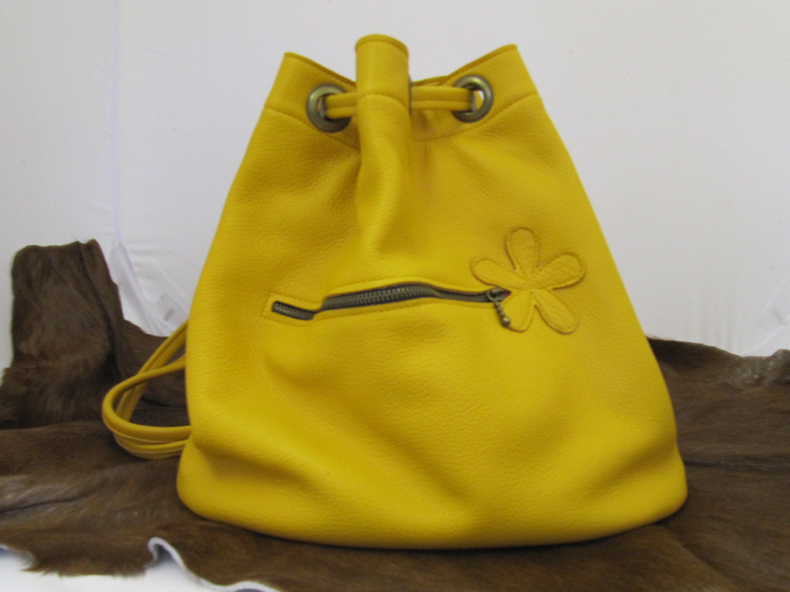 Yellow leather duffle bag