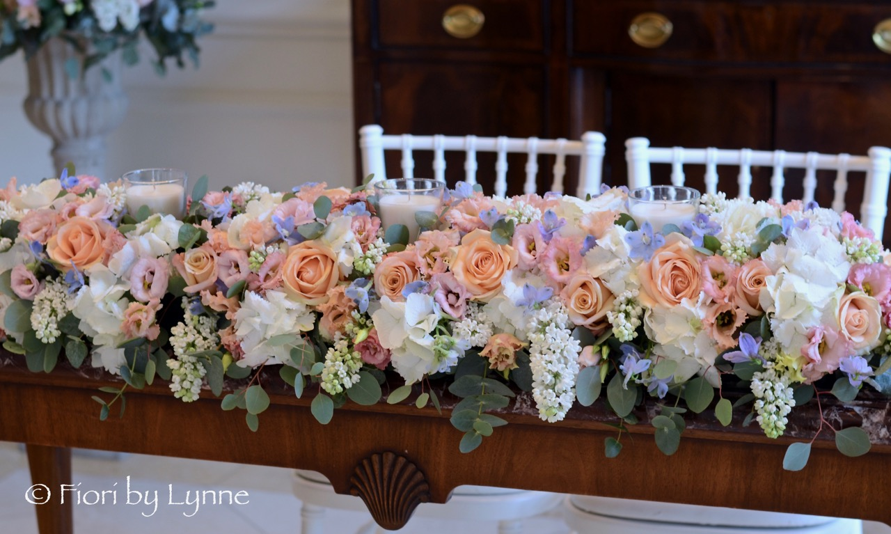 ceremony-table-flowers-wedding-long-low-peach-blue-white.jpg