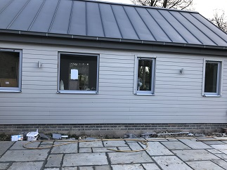 New windows all with trickle vents and new cladding to building project