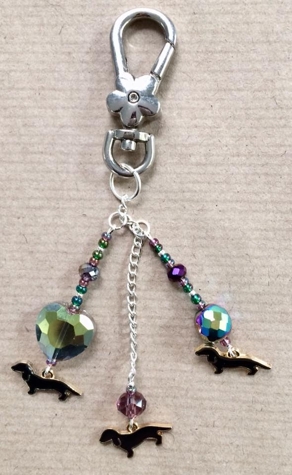 Black sausage dog bag charm with purple beads