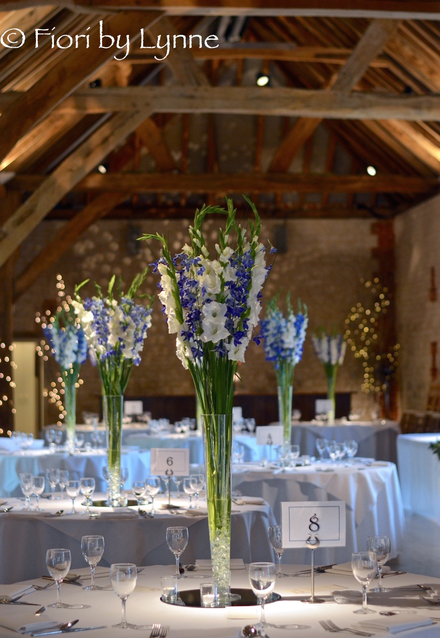 barn-bury-court-tall-centrepiece-blue-delphiniums-white-gladioli1.jpg
