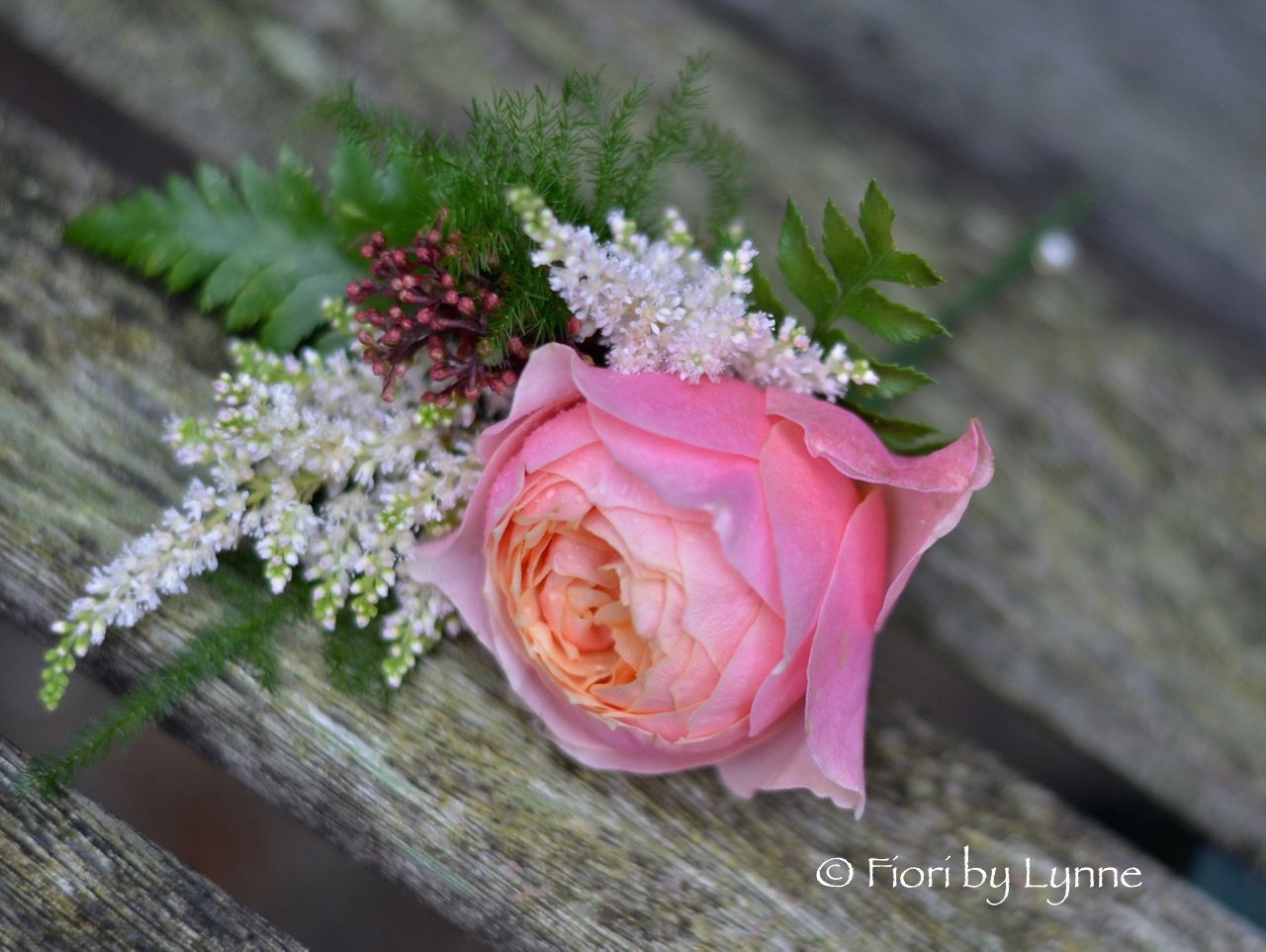 buttonhole-coral-rose-fern-skimmia-astilbe.jpg