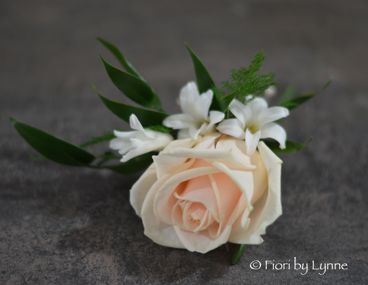 buttonhole-nude-rose-white-hyacinth-pip.jpg