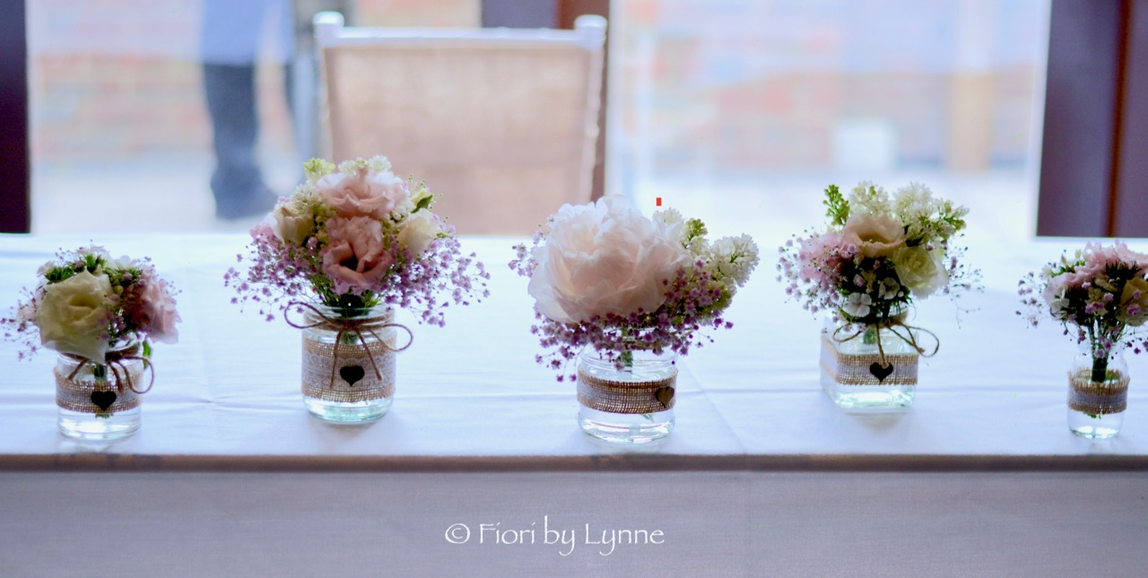 ceremony-table-mixed-jarsbottles-springflowers.jpg