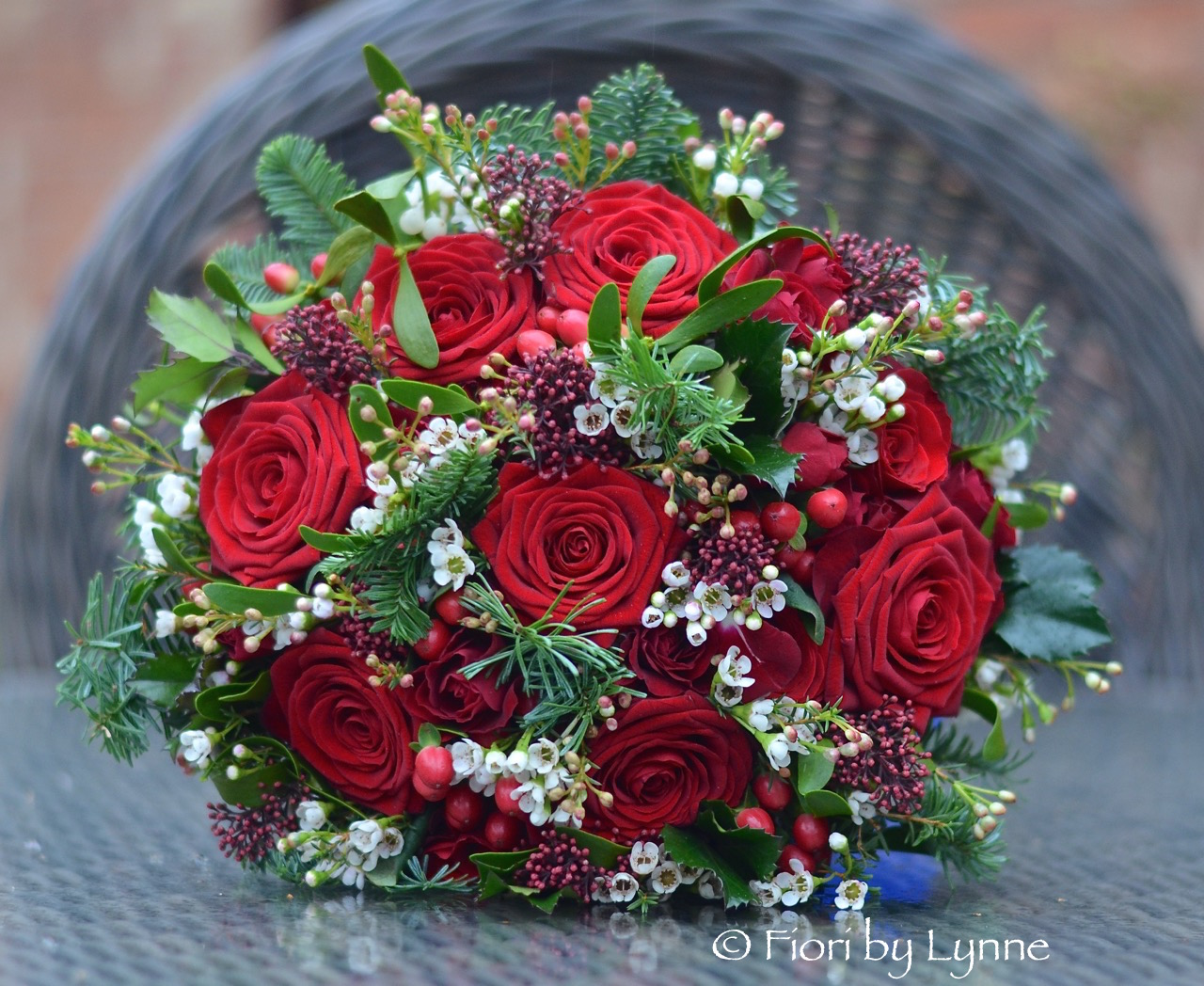 christmas-bouquet-red-rose-berrypine-mistletoe-hollywhite-waxflower.jpg
