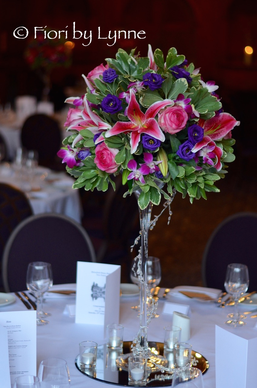 exotic-tall-centrepiece.hotpinkpurple-lily-rose-orchid.jpg