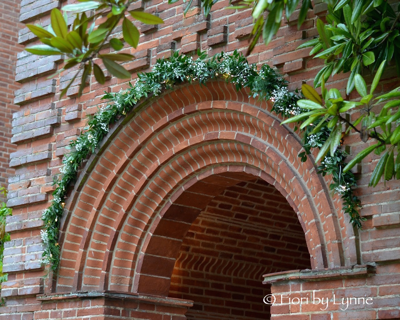 floral-arch-foliage-fairylightsgypnewplace.jpg