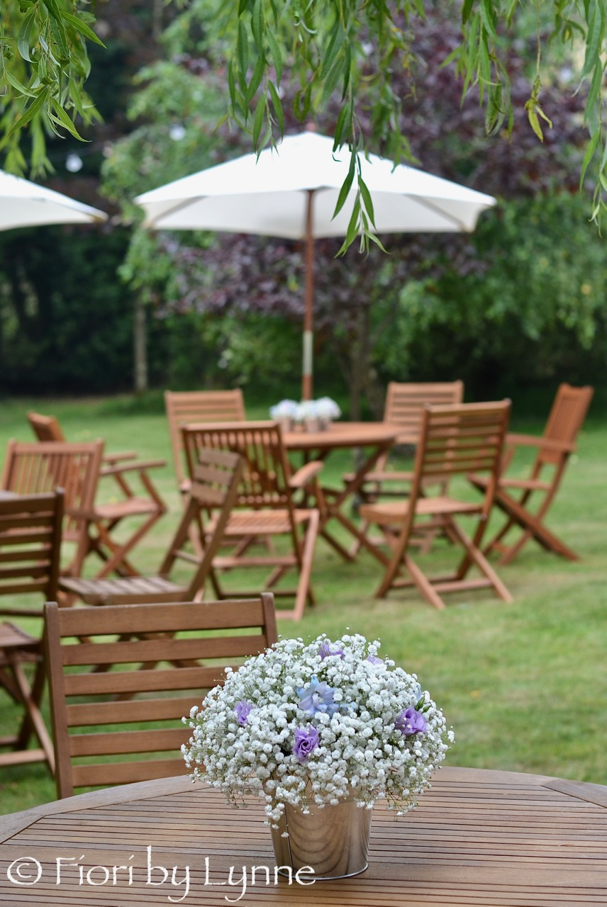 garden-party-wedding-centrepiece-gypsophilablue.delphinium.jpg