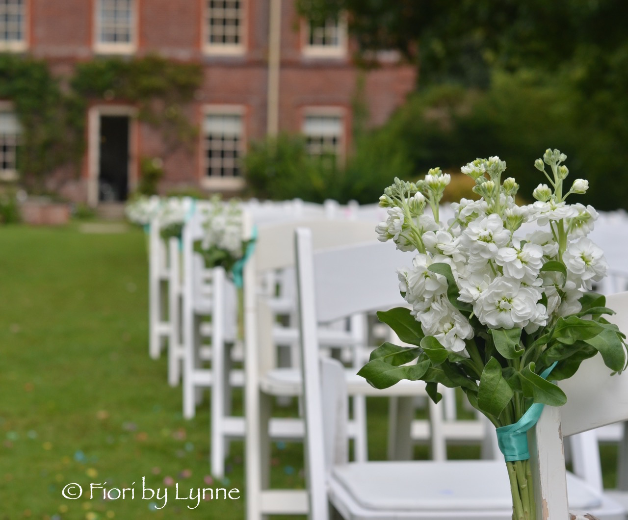 lainston_pavilion-wedding-chair-flowers-tied-bunches-stocks.jpg