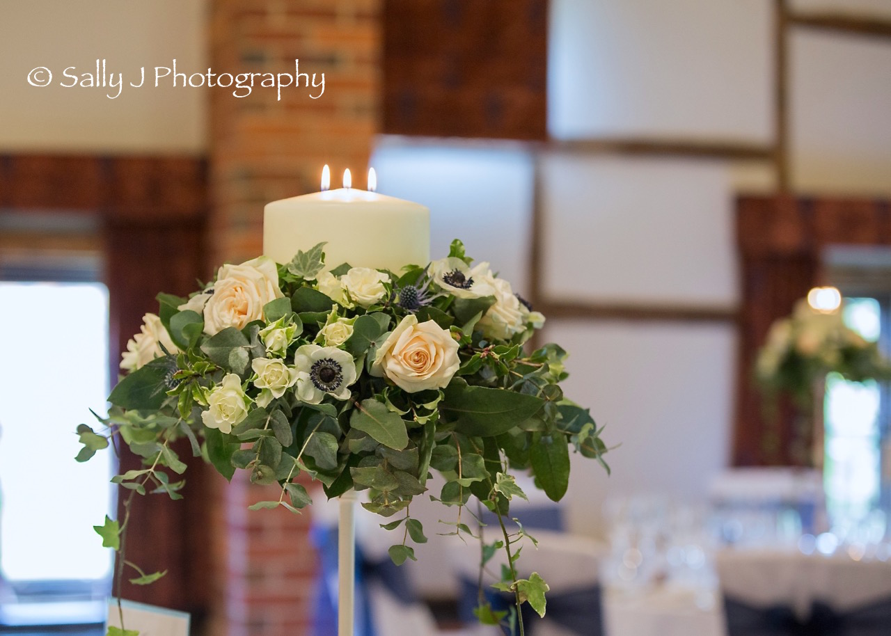 lainstonhouse-tall-tablecentre-with-candle-ivy-trails.jpg