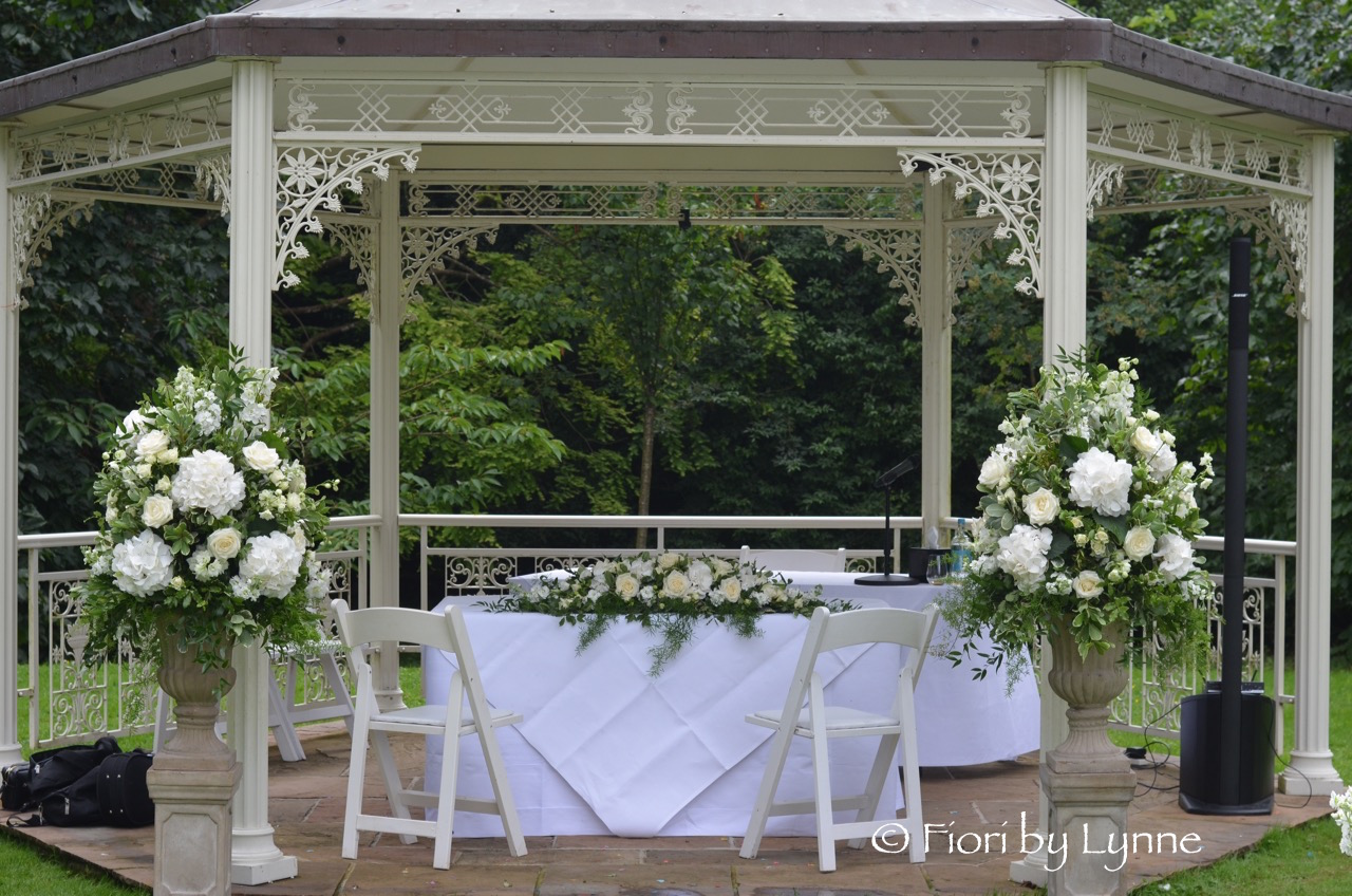 lainstonhouse-wedding-ceremony-flowers-outside-whites-greens.jpg