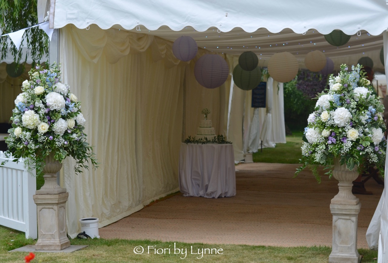 marquee-entrance-wedding.urns.flowers..jpg