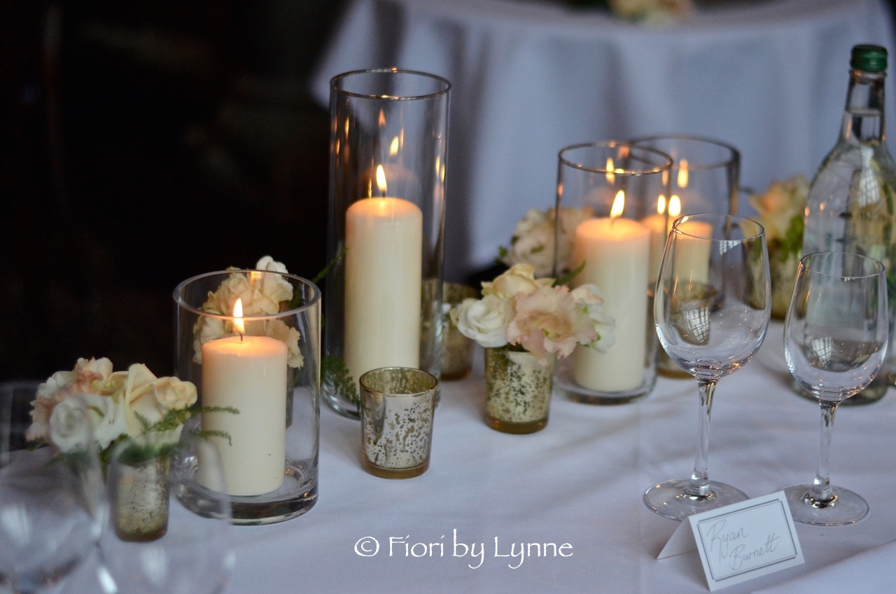modern-winter-wedding-top-table-candlesflowers.jpg