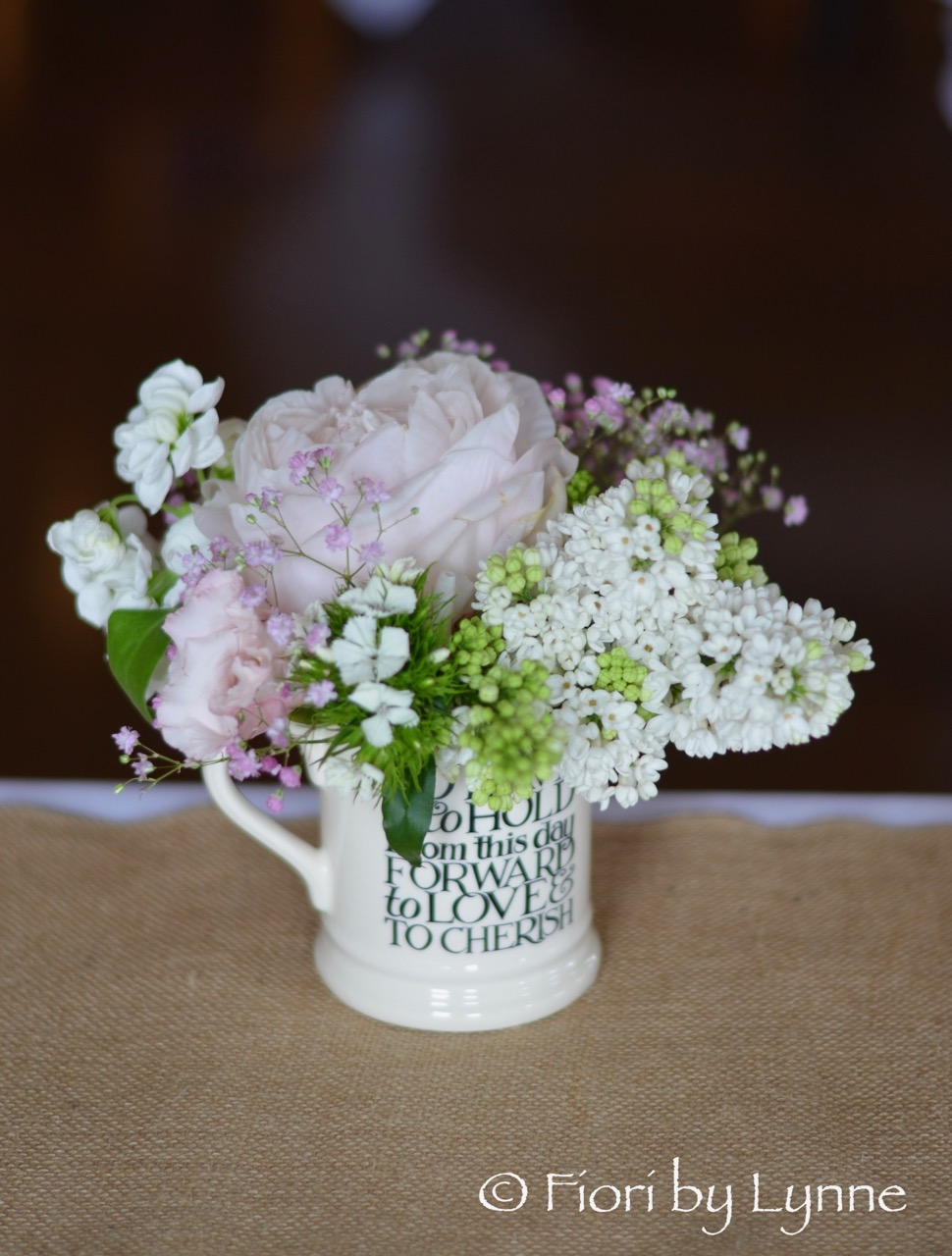 mrmrs-jugs-flowers-for-top-table-shabby-chic-wedding.jpg