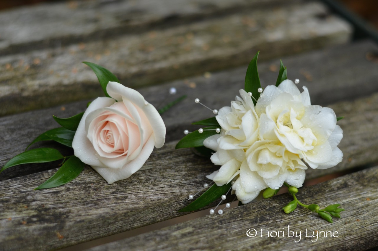 nude-rose-buttonholecorsage-freesia-pearls.jpg