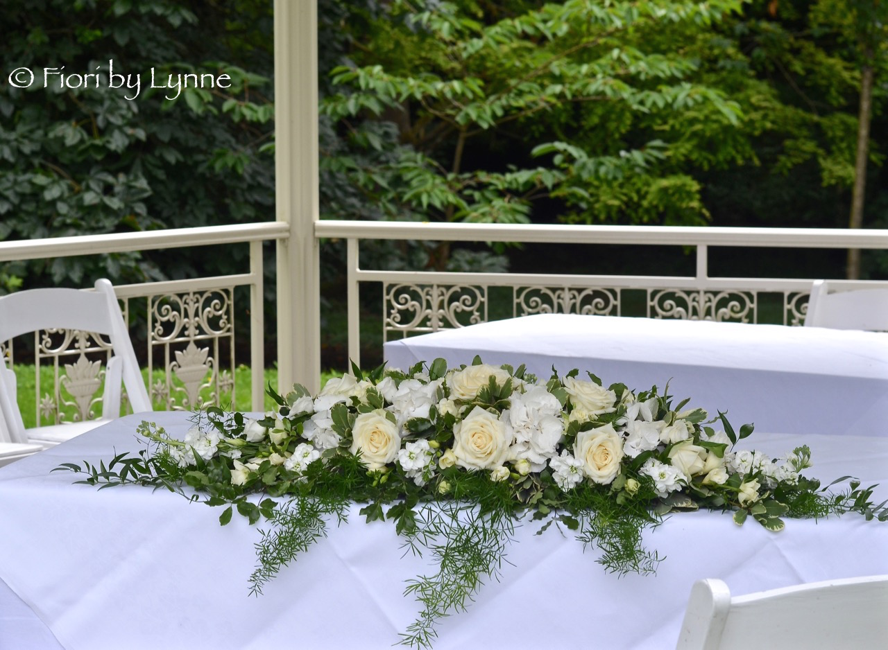 pavilion-lainston-ceremony-table-flowers-classic-longlow.jpg