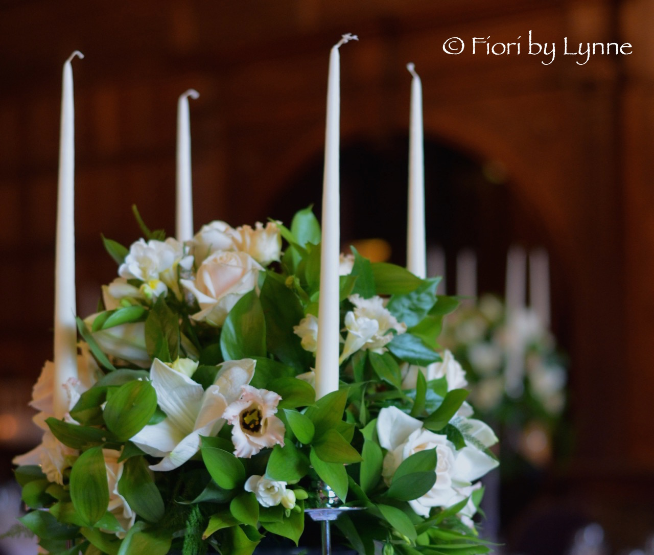 rhinefield-winter-wedding-candelabra-white-amaryllisnude-roselisianthus.jpg