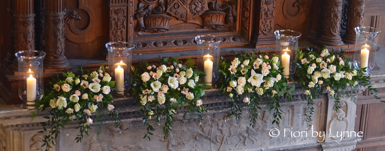 rhinefield-winter-wedding-mantle-flowers-whitesgoldscandleslanterns.jpg