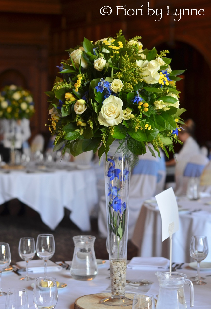 rhinefieldhouse-spring-wedding-yellow-blue-tall-centrepieces.jpg