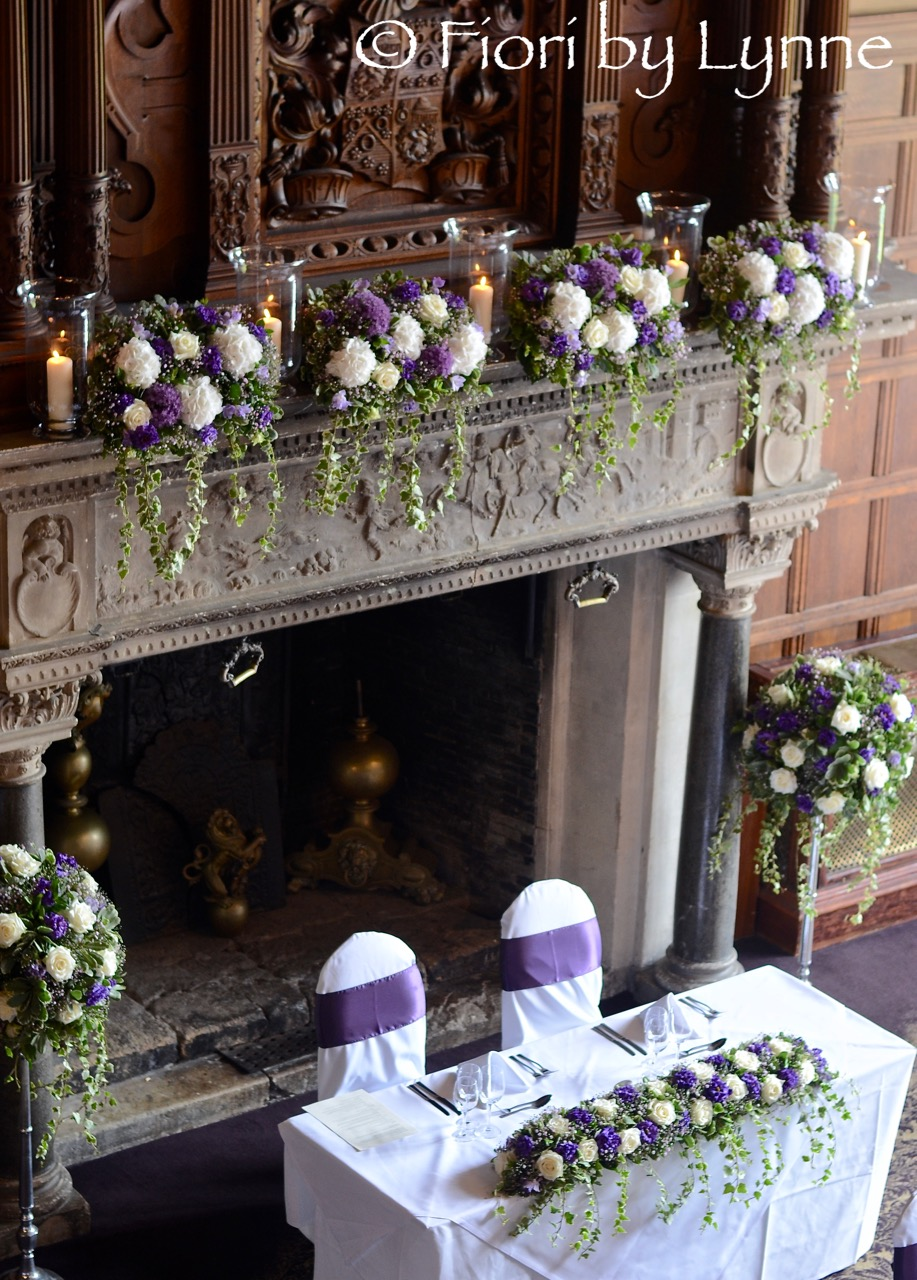 rhinefieldhouse-wedding-tablemantle-flowers-purple-white.jpg