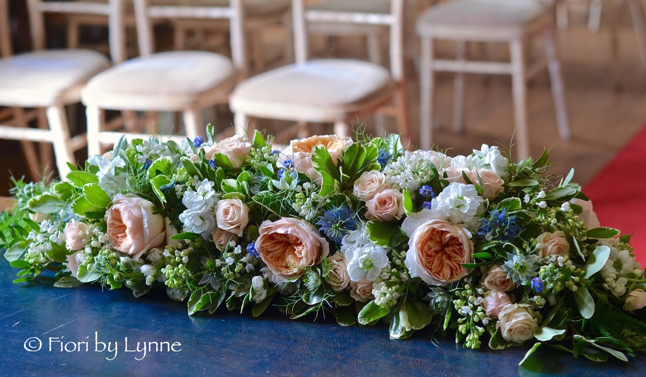 rownhamshouse-ceremony-table-flowers.jpg