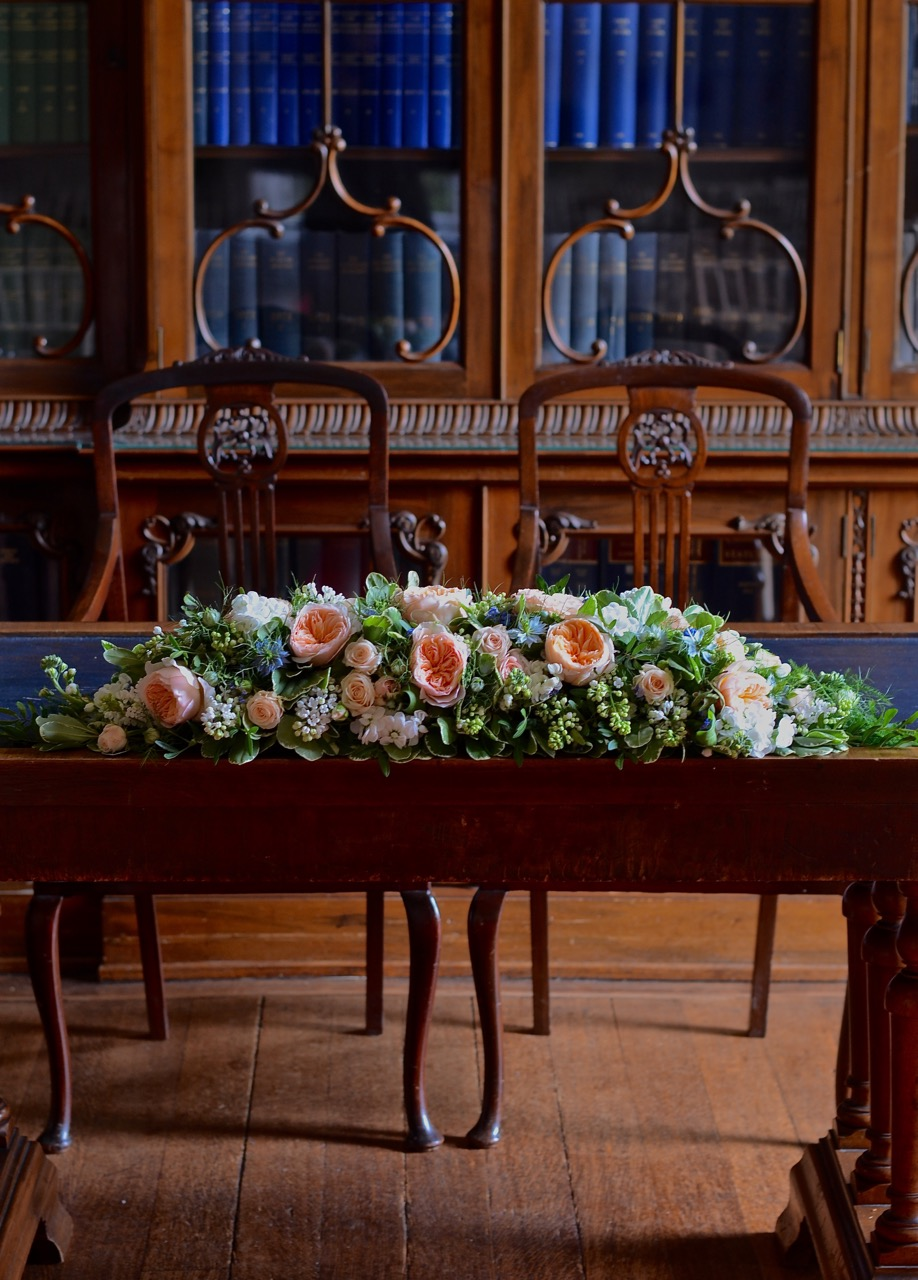 rownhamshouse-wedding-ceremony-tableflowers-peach-blue.jpg