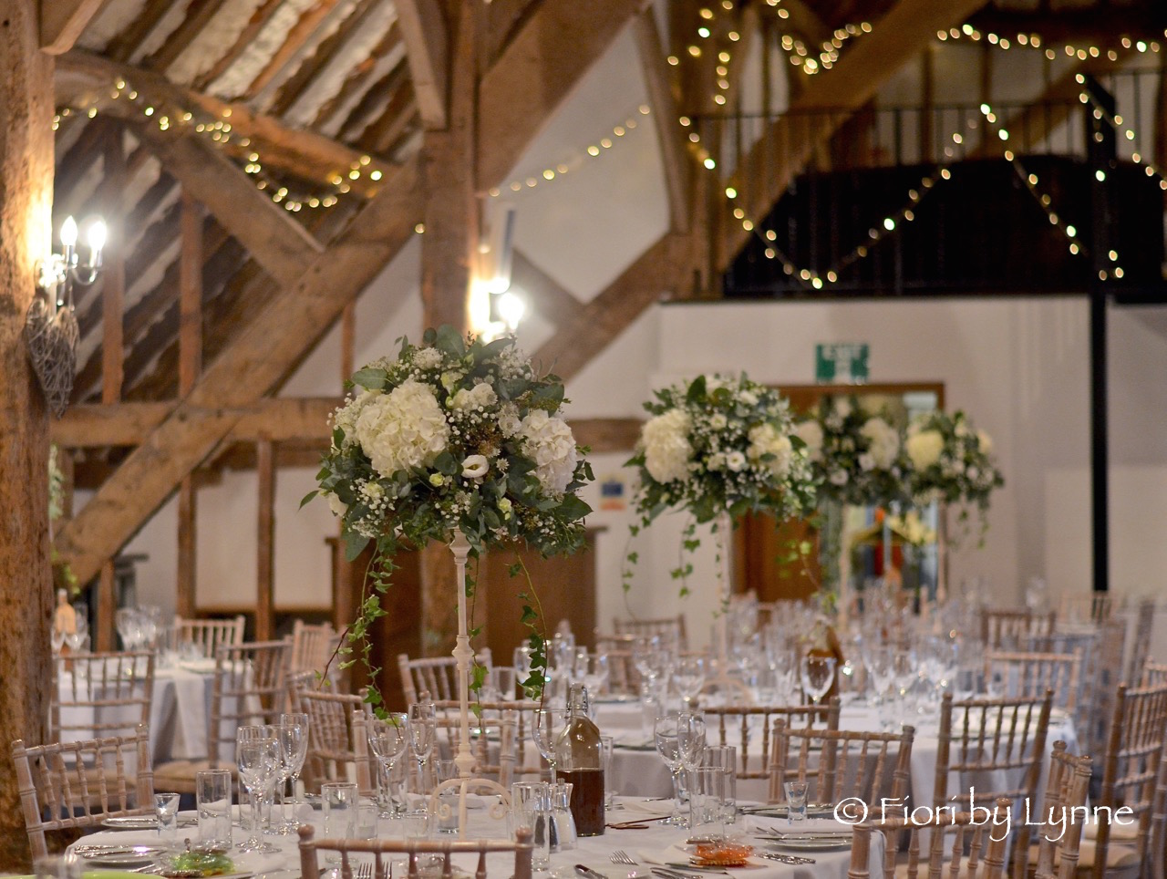 rustic-barn-wedding-tall-centrepieces-whitessilver-fitzleroi.jpg
