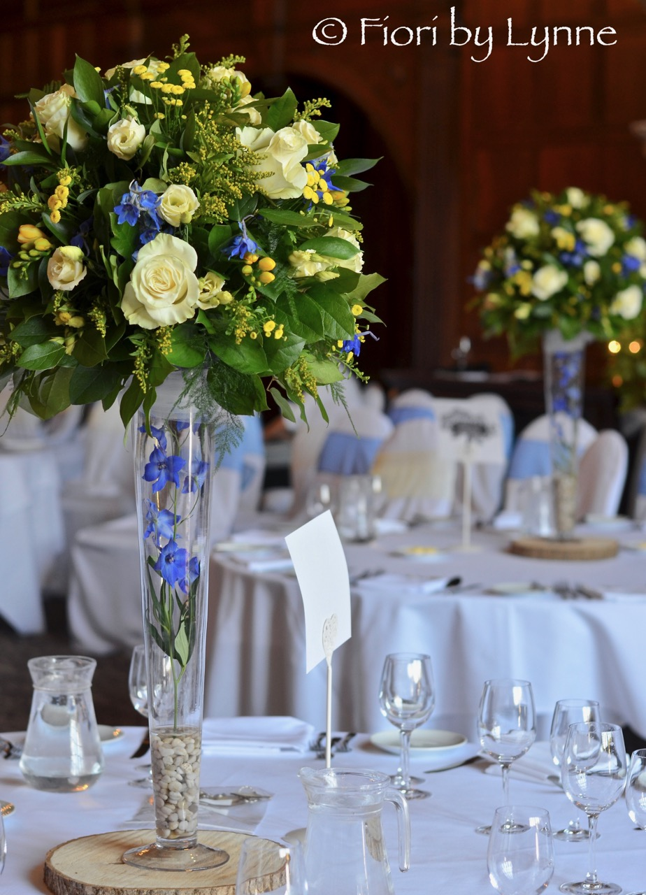 spring-centrepieces-blues-yellows-tall-rhinefieldhouse.jpg