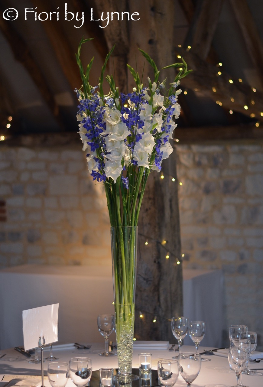 tall-simple-centrepiece-blue-delphiniumswhitegladioli-barn-burycourt.jpg