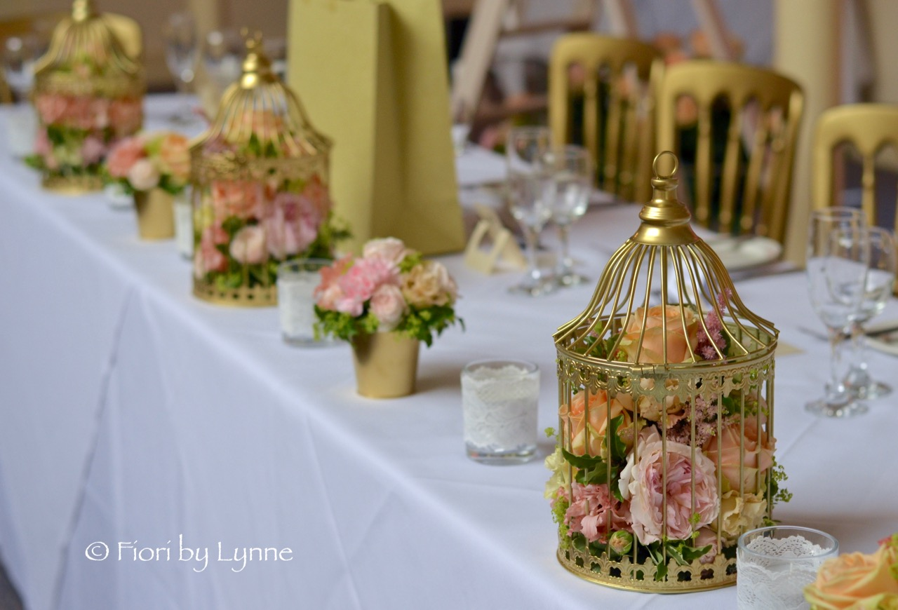 top-table-birdcages-pots-flowers-gold-peach-pink.jpg