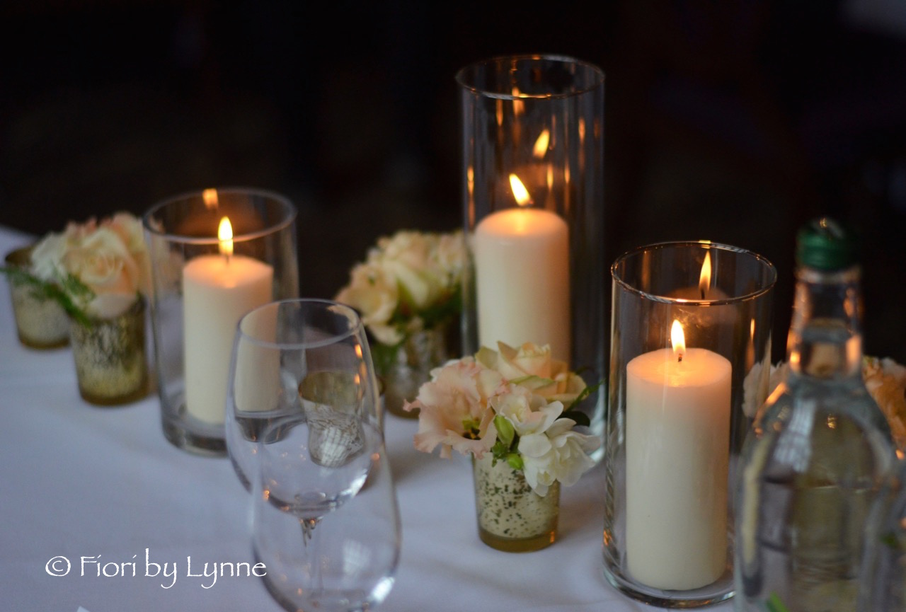 top-table-design-mixed-candlesflowers-whitesandgolds.jpg