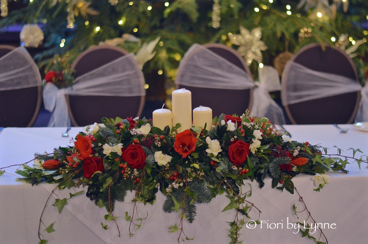 traditional-christmas-top-table-flowers-candles.jpg