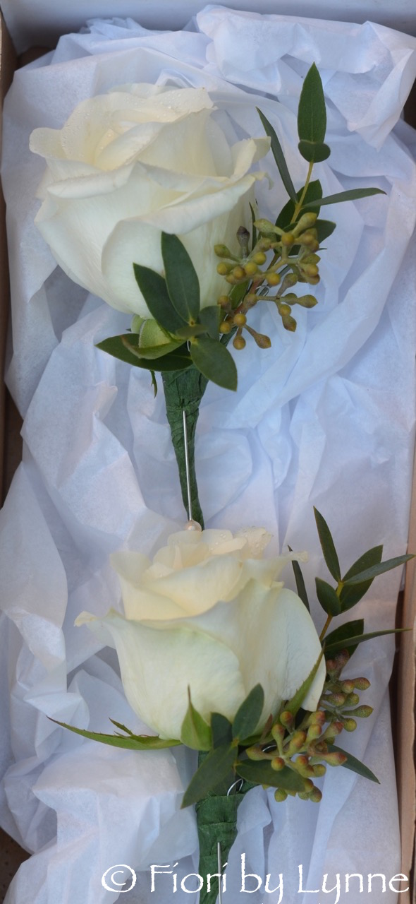 white-rose-eucalyptusberry-buttonholes.jpg
