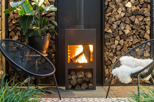 Outdoor Adezz fire with log storage