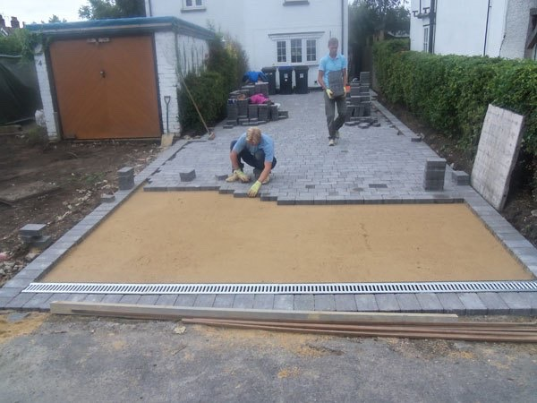 Work underway laying new block paving in Byfleet Block Paving Surrey