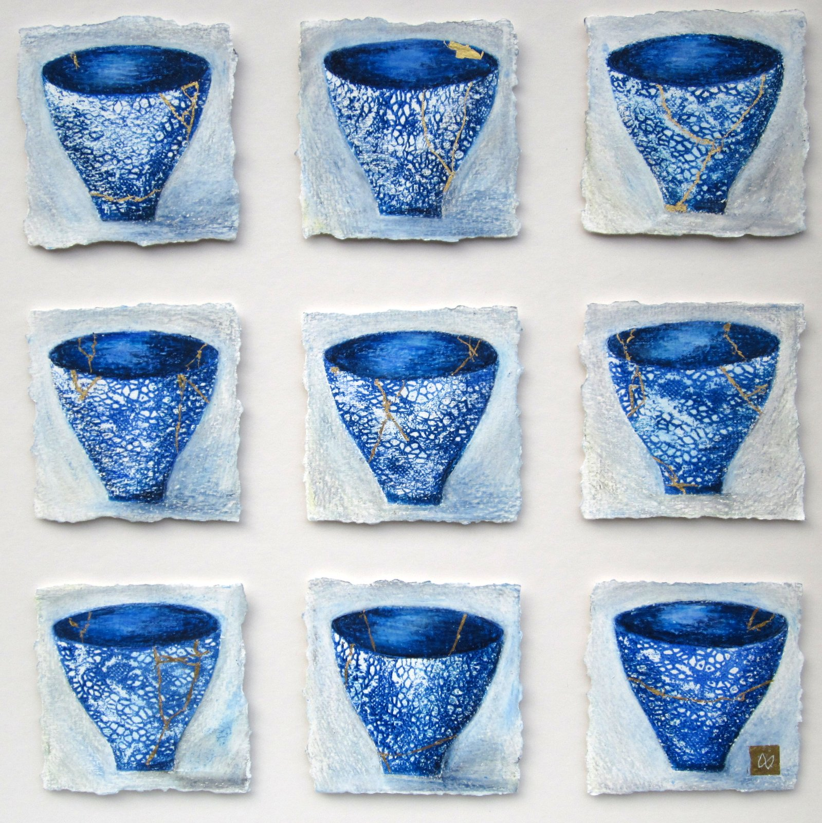 Nine blue lace kintsugi tea bowls with gold repair