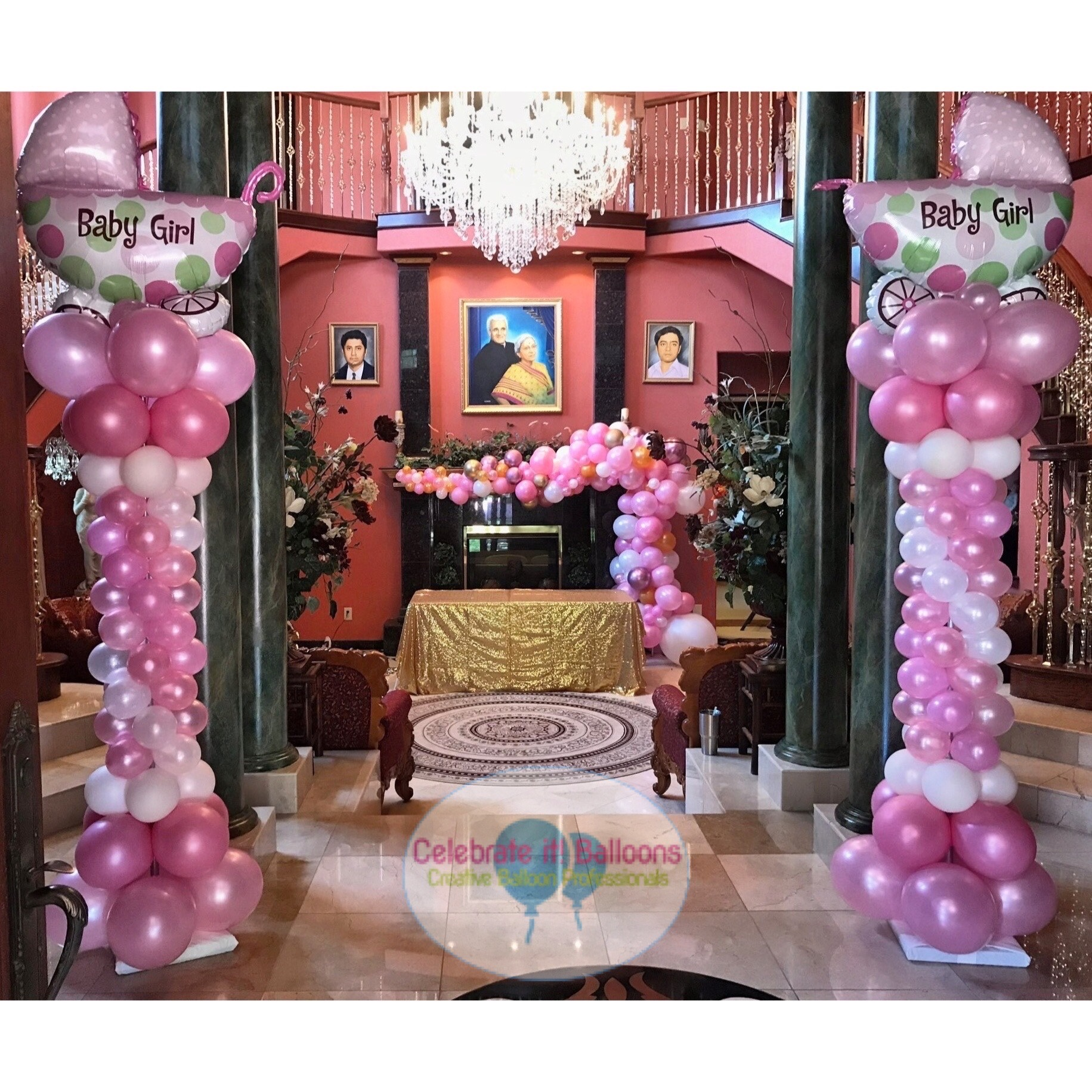 Baby Shower balloon columns in pink and white with balloon garland over fireplace.
