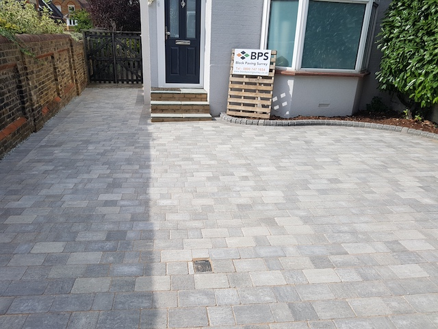 Front view of Silver Haze block pave driveway and side path