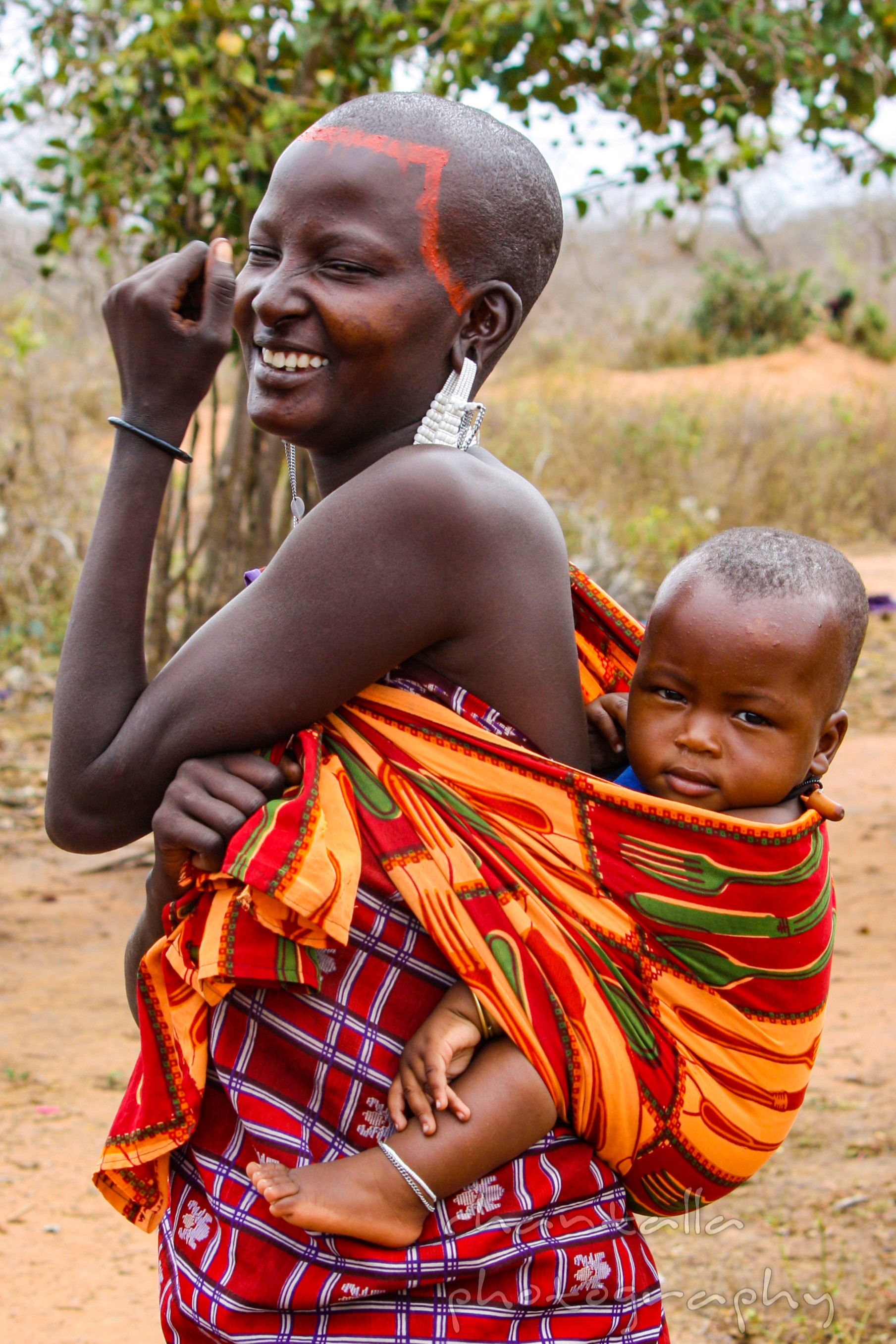 This traditional Masai woman lives in Kenya, and posed for the camera with her beautiful baby.