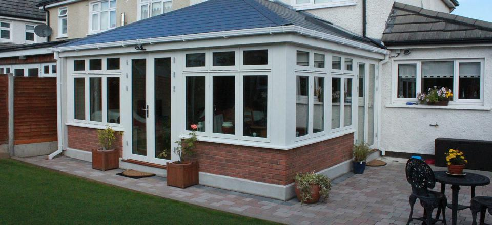 Sunroom with white triple glazed windows