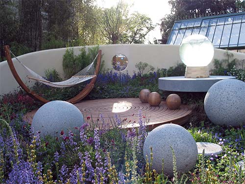 Round intimate area with hammock and decorative spheres