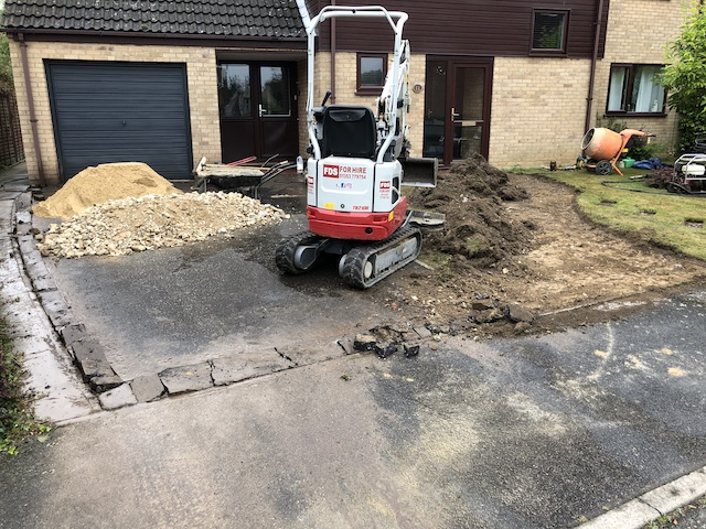 Digging up an old tarmac driveway in Bury St Edmonds
