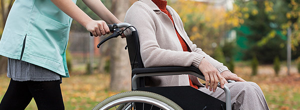 Wheelchair user being assisted