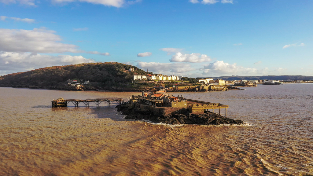 Aerial sequence depicting Birnbeck Pier at Weston-super-Mare, built in 1867 and currently derelict.