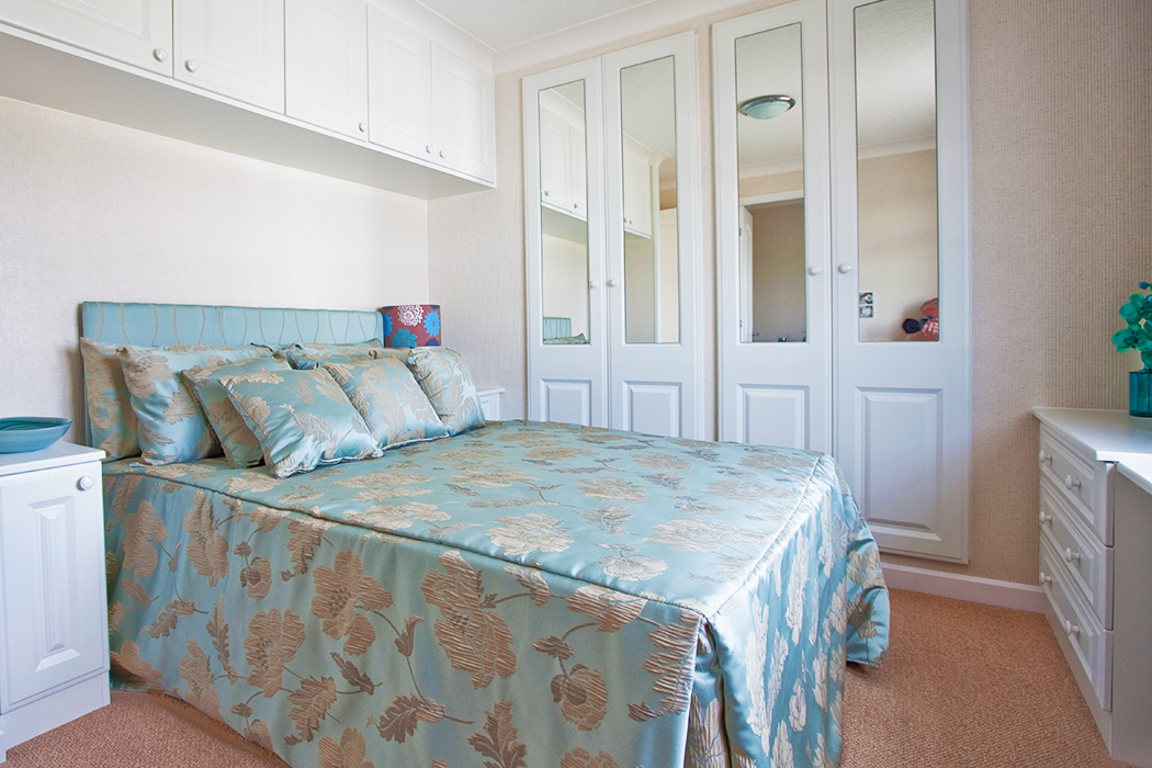 Typical bedroom in one of the retirement park homes for sale at Mossband  Residential Park, South West Scotland